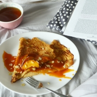 French Crêpes with Boozy Peach Syrup